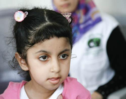 Jaar met het offerfeest de gehandicapte kinderen in de gazastrook
